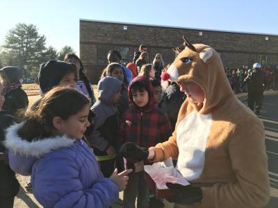 Reindeer handing out treats to our students.